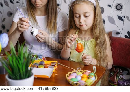 Preparation For The Easter Holiday. Family Celebration Of Easter. Mother And Daughter Are Preparing