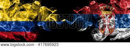 Colombia, Colombian Vs Serbia, Serbian Smoky Mystic Flags Placed Side By Side. Thick Colored Silky A
