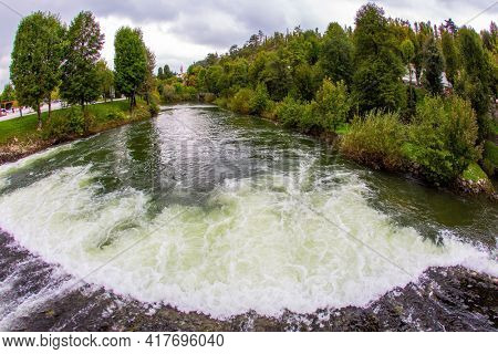 Picturesque river in the huge green park. Postojna Cave. Magical places in Slovenia. The famous and most visited place in the country by tourists. Travel to Eastern Europe.