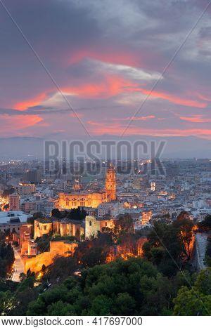 Malaga, Spain cityscape at the Cathedral, City Hall and Alcazaba citadel of Malaga at dusk.