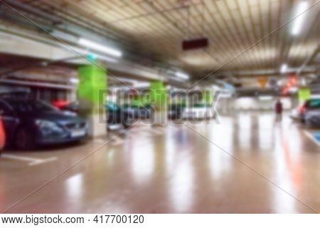 Parking Lot Cars Blurred. Car Lot Parking Space In Underground City Garage. Empty Road Asphalt Backg