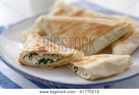 Spanakopita triangles with spinach and cheese