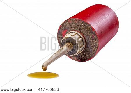 Drop Of Oil Dripping From Dirty Oiler. Accessories For The Maintenance Of Mechanical Devices.