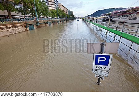 BUDAPEST, HUNGARY - CIRCA 2013: Quayside of river Danube inundating during record high floods in Budapest, June 2013. Traffic sign post under water,