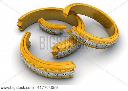 Broken Wedding Rings. Fragments Of Gold Wedding Rings Symbolize The Divorce Proceedings. Divorce Con