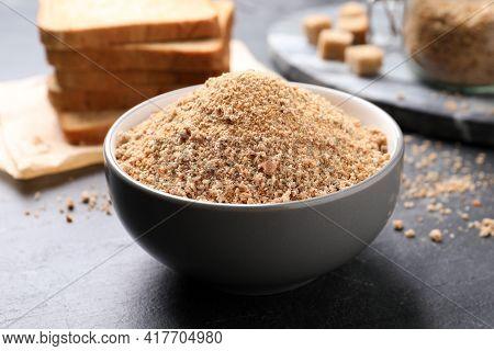 Fresh Breadcrumbs In Bowl On Black Table