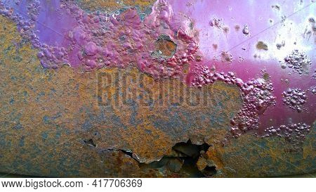 Sheet Metal Corrosion Of Old Car Body. Rusty Steel Surface, Background And Damaged Texture. Stops An