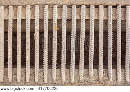 Drainage Ditch With A Grate Of Iron Rods Rebar Dirty In A Swamp, Infrastructure Wastewater System Cl