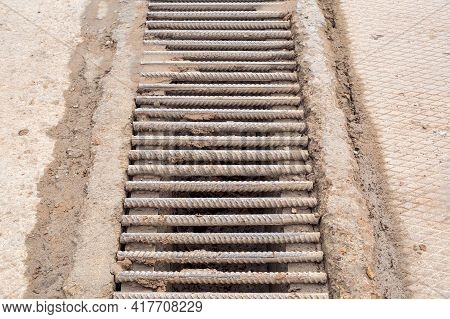 Drainage Grate Made Of Iron Rods Fittings Dirty In A Swamp Made Of Clay, Infrastructure System Of In