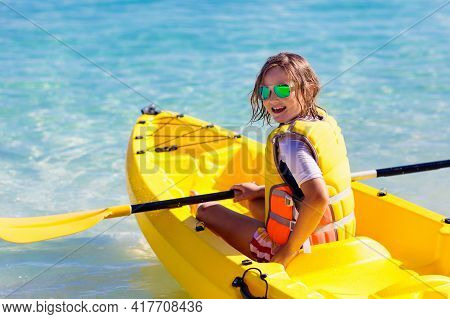 Kids Kayaking In Ocean. Children In Kayak In Tropical Sea. Active Vacation With Young Kid. Little Gi