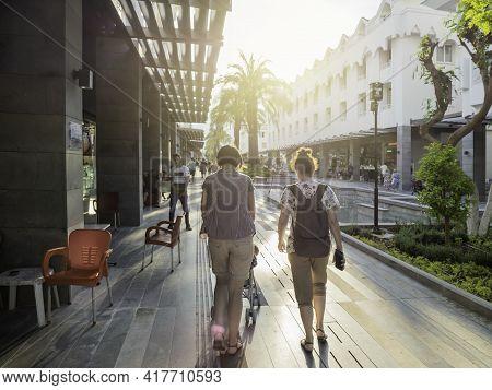 Kemer, Turkey - May 13, 2018. Tourists Walk Down Munir Ozkul Liman Street. Street With Modern Buildi