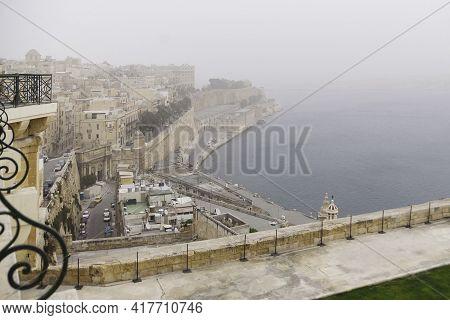 Valletta, Malta - February 20, 2010. Mediterranean Sea Coast At Valletta In Foggy Morning. Misty Vie