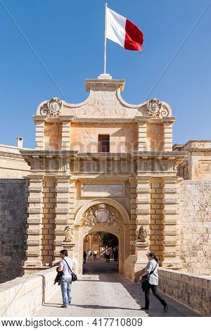 Valletta. Malta - February 18, 2010. Tourists Walk Through Gate Of Mdina, Ancient Capital Of Malta.