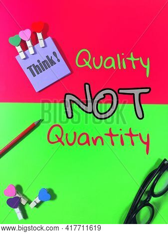 Pencil, Glasses And Note Paper Wording Think! With Love Clamps And Also A Written Quality Not Quanti