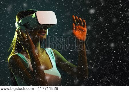 Black Asian Woman Wearing Vr Headset Goggle To Get Excite Experience Of Virtual Reality Technology,