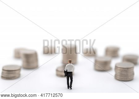 Business, Money Investment And Planning Concept. Businessman Miniature Figure People Figure Walking