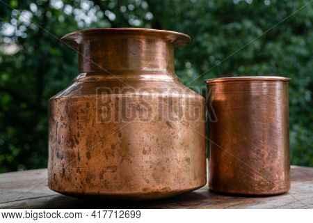 A Copper Water Holder And A Glass. In Indian Ayurvedic Culture It Has Been Established That Drinking