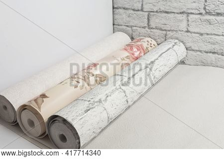 Three Multi-colored Rolls Of Wallpaper For Apartment Renovation. Apartment Renovation Concept.