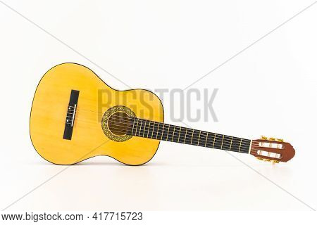 Close Up Acoustic Guitar Isolated On White Background