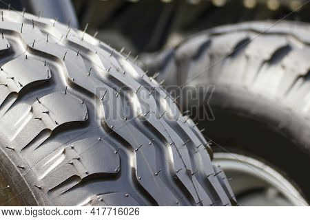 Black Tyre Using In Vehicle, Tractor Or Other Industrial And Agricultural Machine. Transportation
