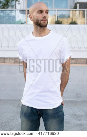 Minimal white t-shirt men's fashion apparel outdoor shoot