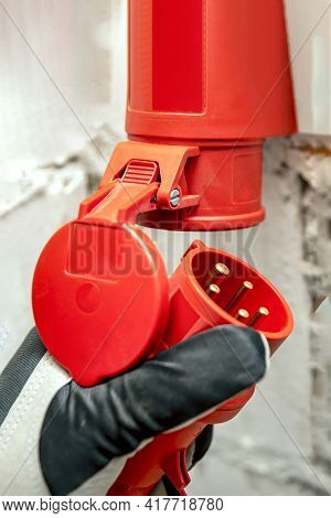 Electricity Cost, Electricity Price, High Voltage Industrial Socket. High Voltage Plug In Hand. Conn