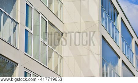 A Fragment Of Modern Architecture, Walls And Glass. Windows And Balconies Of A Residential Building