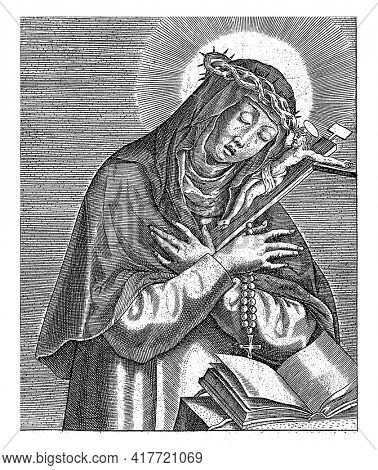 Saint Catherine of Siena holding a crucifix and a rosary.