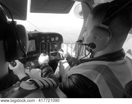 Pilot instructor teach student flight. Small private airclub and pilots school. 27 March 2021. Kiev Region, Ukraine