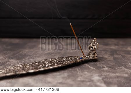 Traditional Oriental Aromatherapy. The Subject Of Rituals. Incense Stick Burning On A Metal Stand. I