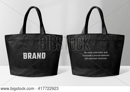 Black tote bag with BRAND typography
