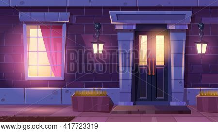 House Facade With Door And Window At Night. Home Entrance With Light From Lanterns On Brick Wall And