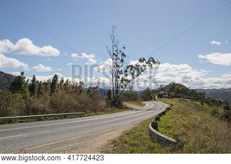 Winding Tarmac Road Through Dry Rural Area