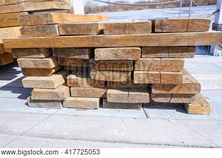 Folded Wooden Planks. Construction Industry. For Construction And Finishing Works. Wooden Beams And
