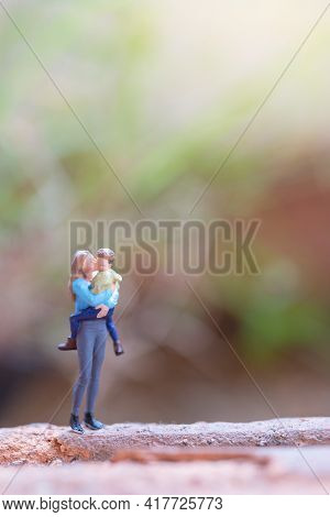 Miniature People Mother Holding Her Cute Baby ,happy Mothers Day Concept