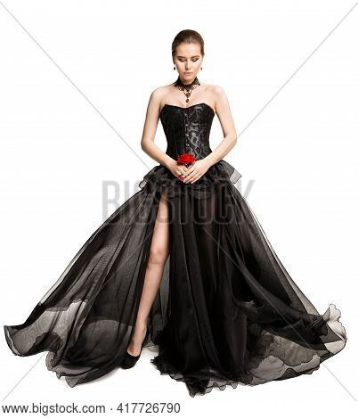 Beautiful Woman In Black Evening Gown Looking Down, Full Length Vintage Fashion Flying Chiffon Dress