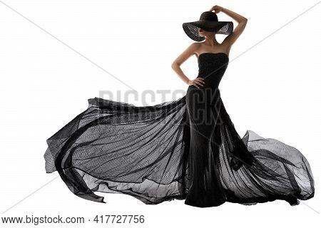 Woman Black Dress Fashion. Elegant Lady In Hat. Model Silhouette In Evening Long Black Gown Flutteri