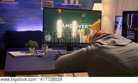 Over Shoulder Shot Of Man After Losing At Video Games