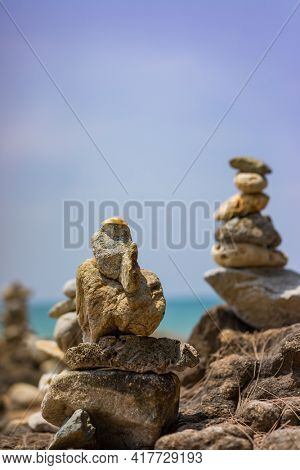 Balanced stones on the beach in Lak-Lam Ru National Park Thailand