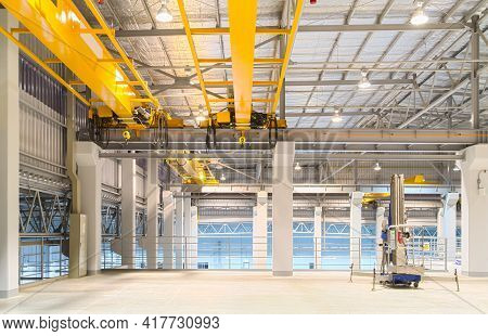 Concrete Floor Inside Factory Or Warehouse Building With Empty Space For Industry Background. Overhe