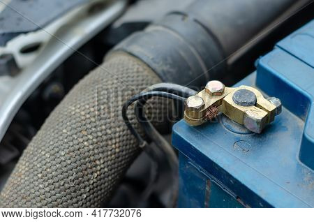 12 Volt Car Battery Terminals. Close-up Of The Negative Terminal Of A Blue Battery. Vehicle Electric