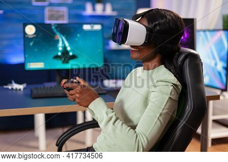 Professional Esport Player With Vr Headset Using Joystick