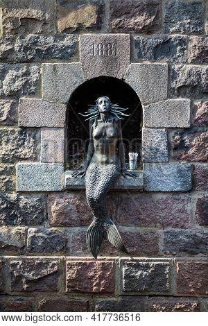 Vilnius, Lithuania - April 10, 2021: Iconic Sculpture Of Mermaid By Romas Vilciauskas On The Embankm