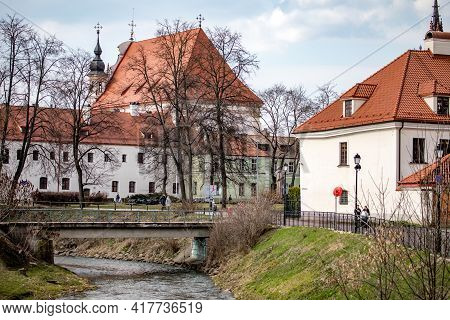 Vilnius, Lithuania - April 10, 2021: Vilnele River With The View Of Vilnius Old Town And Church Of S