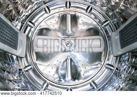 Inside View Of Metal Washing Machine Tank.