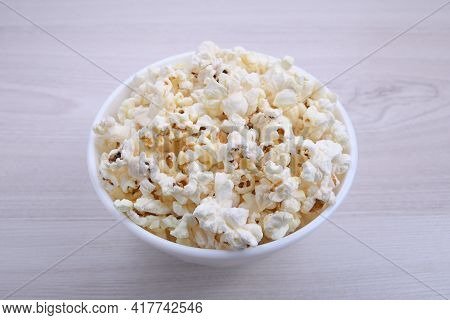 Popcorn In Bowl On A Red Background. Close Up. Top View