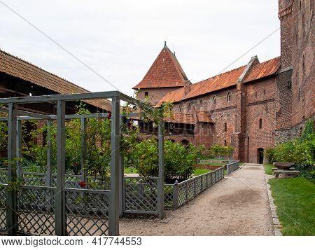 Malbork, Poland - Sept 8, 2020: Garden At Malbork Castle, Formerly Marienburg Castle, The Seat Of Th