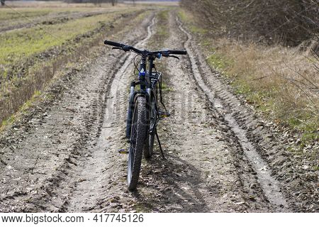Bike Stands On In The Field. A Mountain Bike Stands On A Field Path. Outdoor Cycling Activities. On