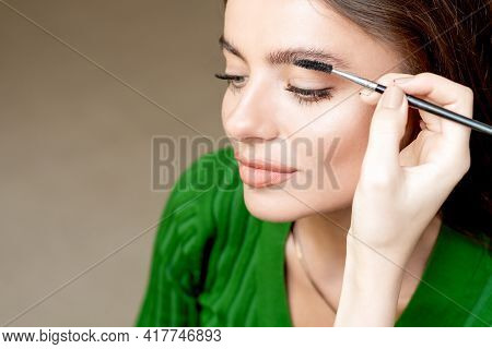 Makeup Artist Combs Eyebrows With Eyebrow Brush Tool Copy Space.