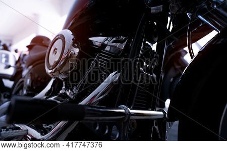 Selective Focus On A Motorcycle Engine. Closeup Motorcycle Exhaust Pipe, Engine Guard, Air Filter, A